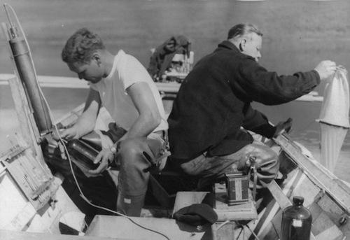 Scientists collecting water samples at Karluk Lake.